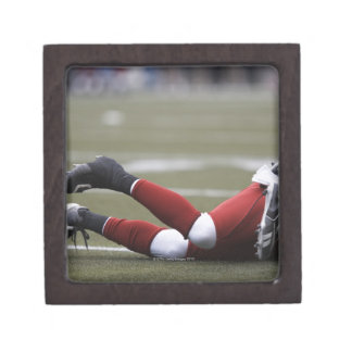 Two American football players lying on field, Premium Gift Box