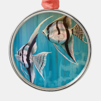 Two angel fish with silver and black and blue metal ornament