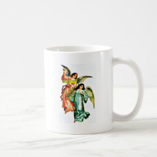 Two angels one holds christmass tree and the other mug