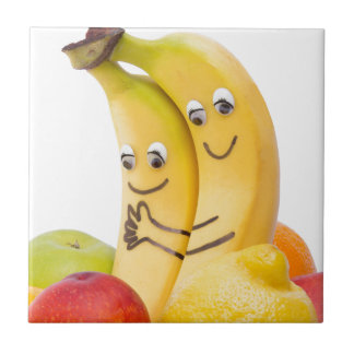 Two bananas with eyes and mouth ceramic tile