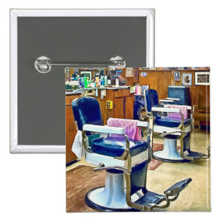 Two Barber Chairs With Pink Striped Barber Capes Button