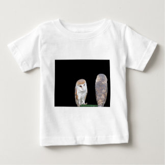Two barn owls isolated on dark background baby T-Shirt