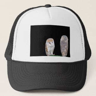 Two barn owls isolated on dark background trucker hat