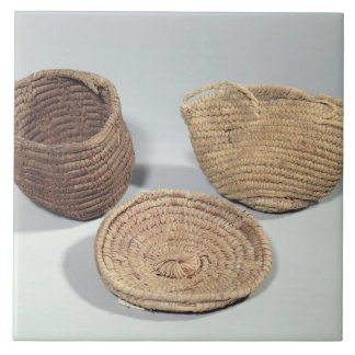 Two baskets and a cover (woven palm fronds) ceramic tile