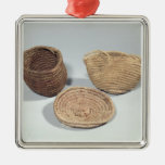 Two baskets and a cover (woven palm fronds) metal ornament