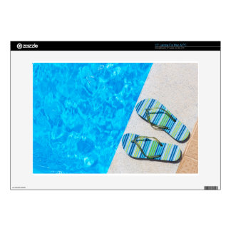 """Two bathing slippers on edge of swimming pool decal for 15"""" laptop"""