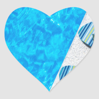 Two bathing slippers on edge of swimming pool heart sticker