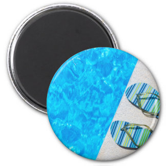 Two bathing slippers on edge of swimming pool magnet