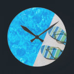"""Two bathing slippers on edge of swimming pool round clock<br><div class=""""desc"""">Two bathing slippers on edge of swimming pool</div>"""