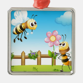 Two bees inside the wooden fence metal ornament