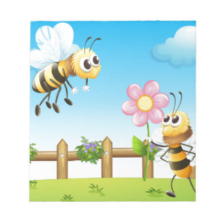 Two bees inside the wooden fence notepad