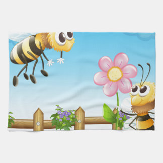 Two bees inside the wooden fence towel
