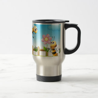 Two bees inside the wooden fence travel mug