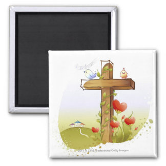 Two birds perching on a cross magnet