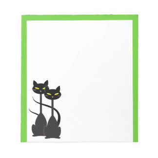 Two Black Cats with Long Necks on Green Notepad