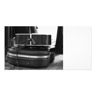 Two black guitar cases in bw picture card