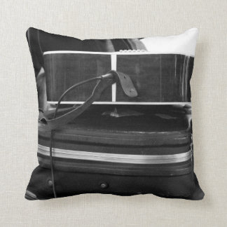 Two black guitar cases in bw throw pillow