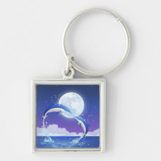 Two bottle-nosed dolphins jumping out of water keychain