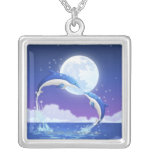 Two bottle-nosed dolphins jumping out of water square pendant necklace