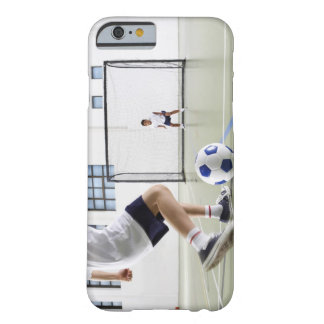Two boys, aged 8-9, playing soccer in a school barely there iPhone 6 case