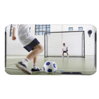 Two boys, aged 8-9, playing soccer in a school barely there iPod case
