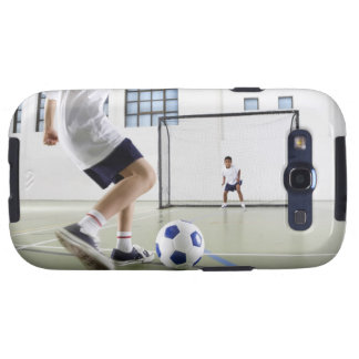 Two boys, aged 8-9, playing soccer in a school galaxy SIII cases
