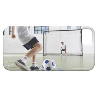 Two boys, aged 8-9, playing soccer in a school iPhone SE/5/5s case