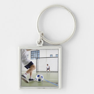Two boys, aged 8-9, playing soccer in a school key chains