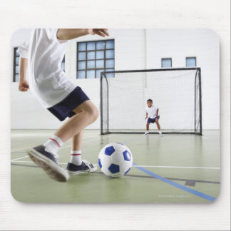 Two boys, aged 8-9, playing soccer in a school mouse pad