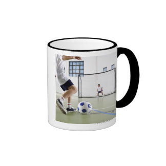 Two boys, aged 8-9, playing soccer in a school ringer mug