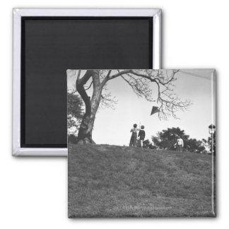 Two boys flying kite on hill B&W Fridge Magnets