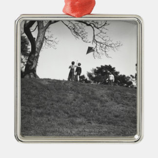 Two boys flying kite on hill B&W Metal Ornament