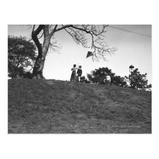 Two boys flying kite on hill B&W Postcard