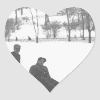 Two Boys Pulling Two Girls on Sleds Heart Sticker