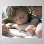 Two boys writing together print