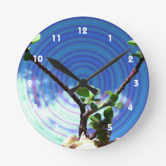 Two branches plant with spiral jpg clocks