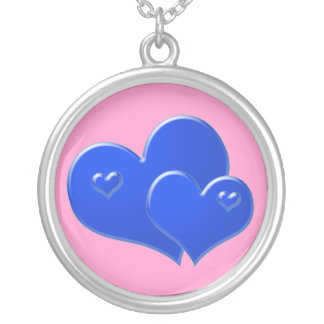 Two bright blue hearts on pink round pendant necklace