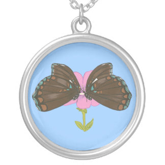 Two brown butterflies on a pink flower necklace