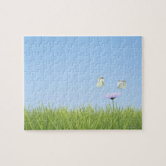 Two butterflies hovering over flower jigsaw puzzle