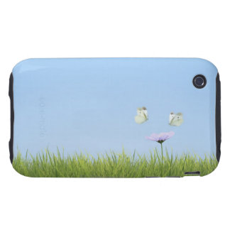Two butterflies hovering over flower tough iPhone 3 case