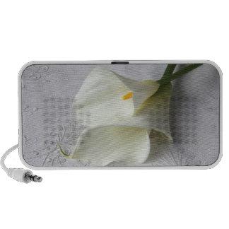 two calla lilies on linen speaker