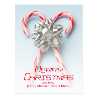 Two candy canes criss-crossed under a silver bow postcard