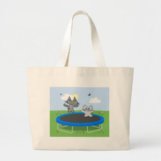 Two Cats Play On A Trampoline Canvas Bag