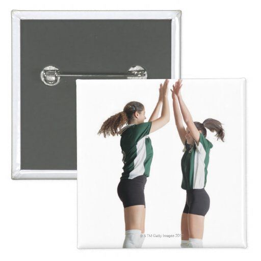 two caucasian female volleyball players from the pin