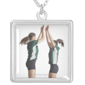 two caucasian female volleyball players from the pendants
