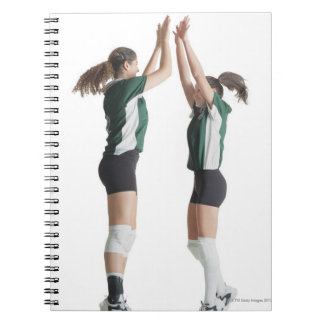 two caucasian female volleyball players from the notebook