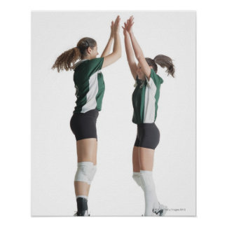 two caucasian female volleyball players from the poster