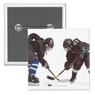 two caucasian hockey players wearing opposing pinback button