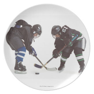 two caucasian hockey players wearing opposing plate