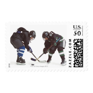 two caucasian hockey players wearing opposing postage